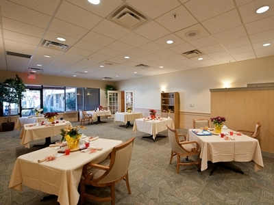 Dining Room with Tables at Village on the Green