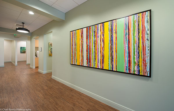 Hallway View Showing Colorful Artwork at Sage Dental in Oviedo, FL