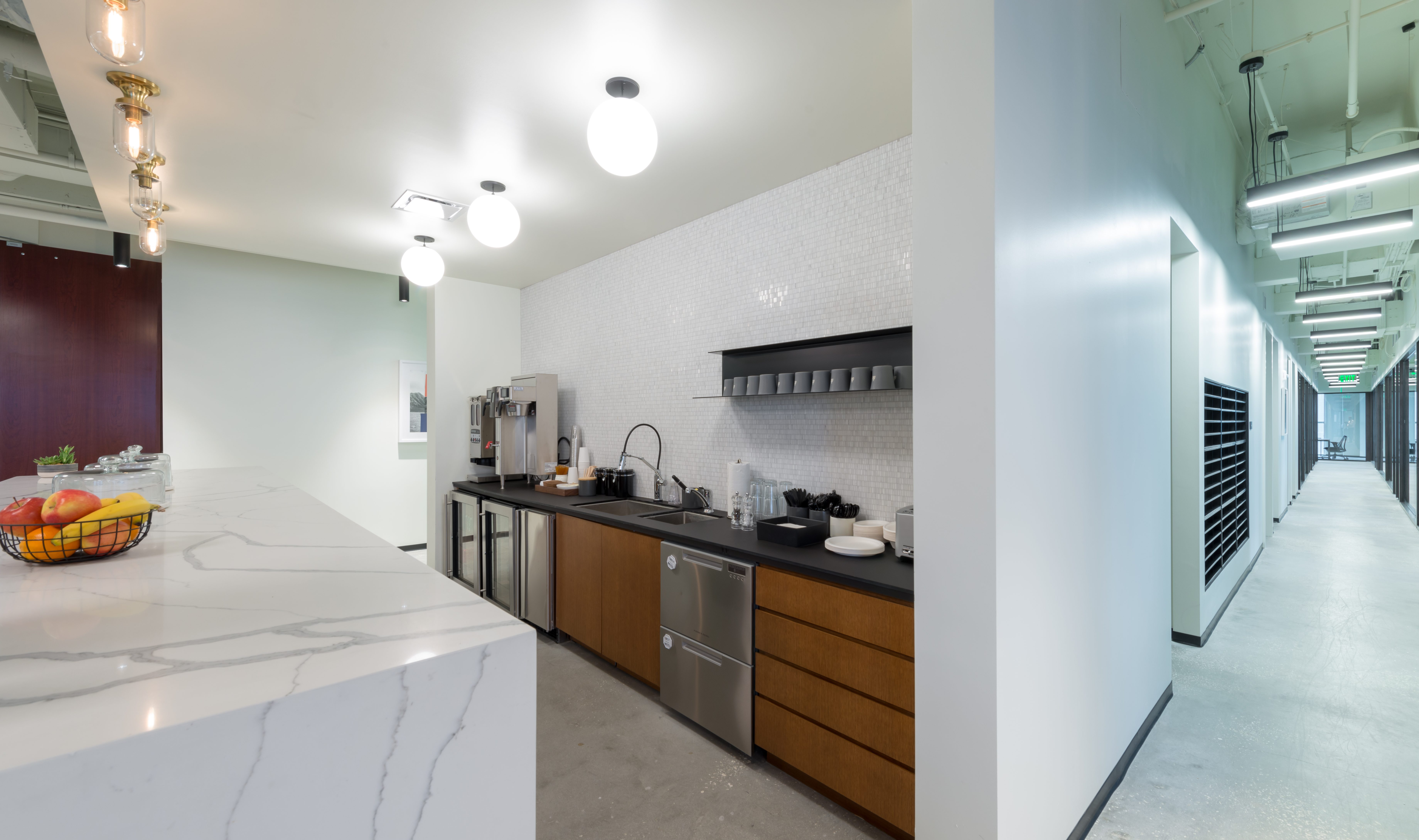 Industrious Kitchen Area Showing Tile Wall and Modern Design