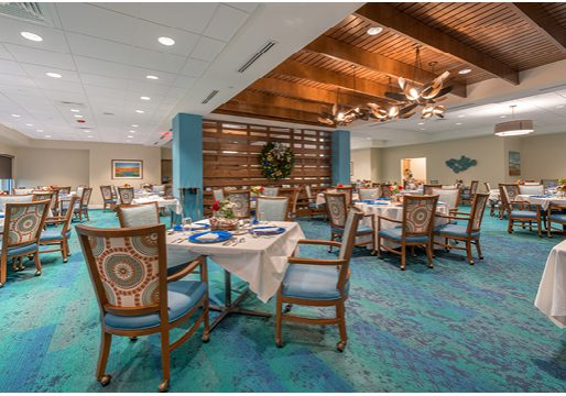 AGC completed the dining room renovation/expansion for the Mayflower Retirement Community in Winter Park, FL.  This 5,300 sq ft project included some beautiful details such as, glass tile accent walls, wood accent dividing walls, and a dramatic wood suspended ceiling.